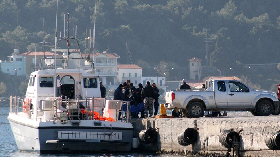 Coast guard removes bodies in harbour at Samos (James Reynolds)