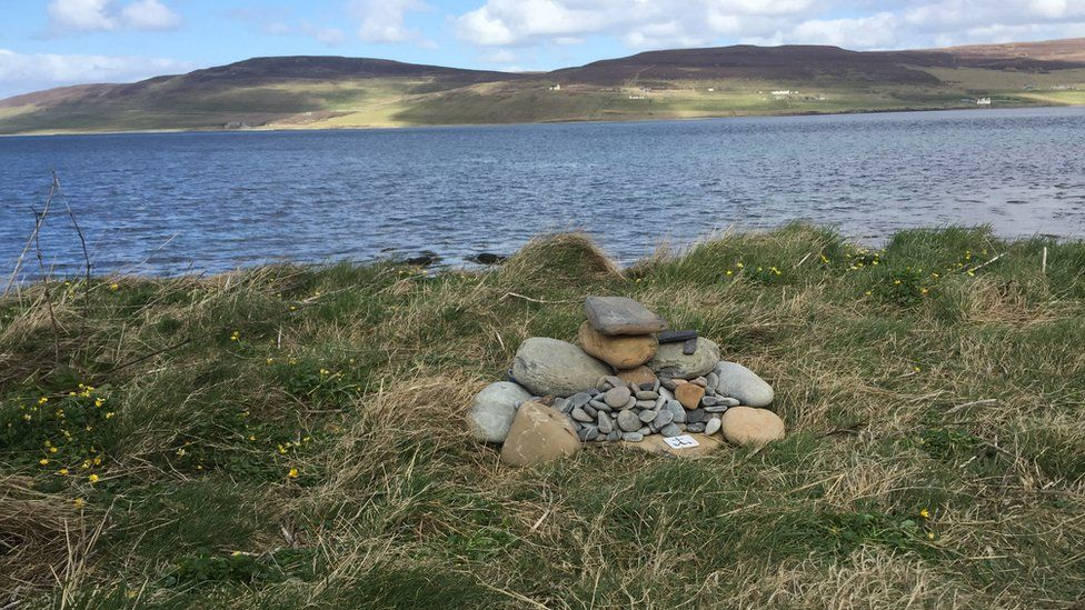 Cairn of stones by the coast