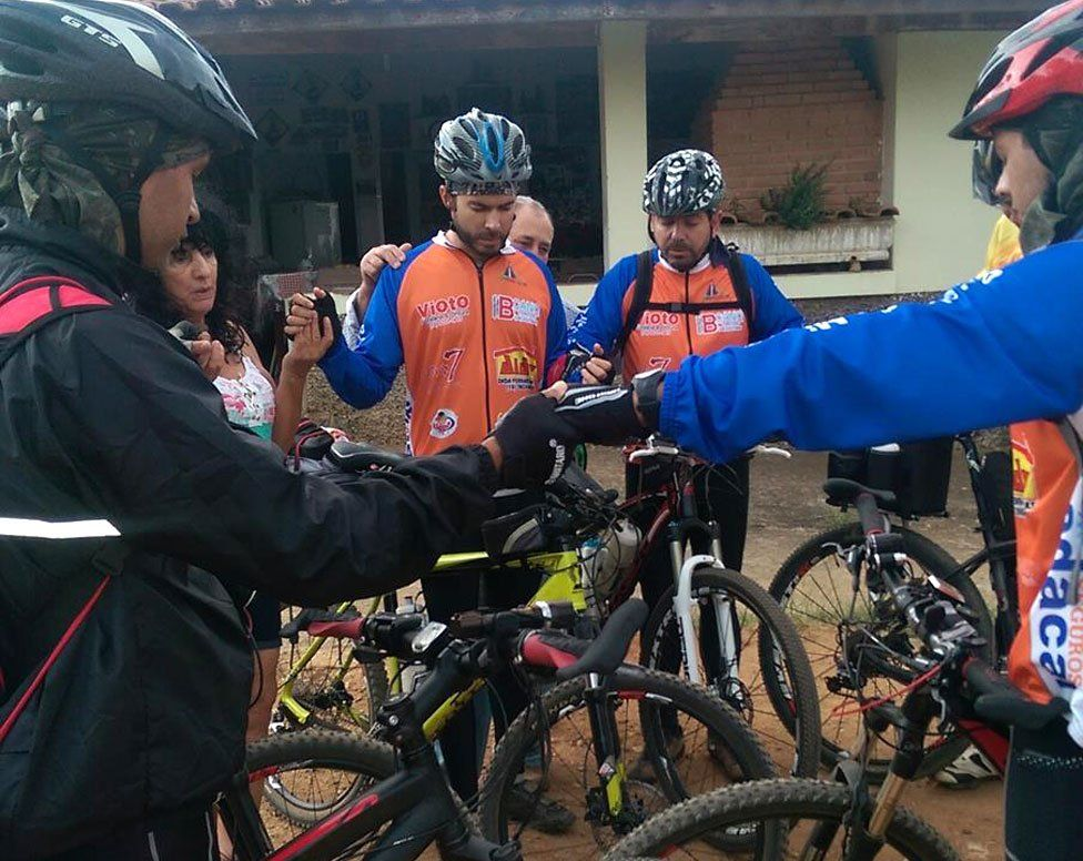 Cyclist-pilgrims join together for morning prayers