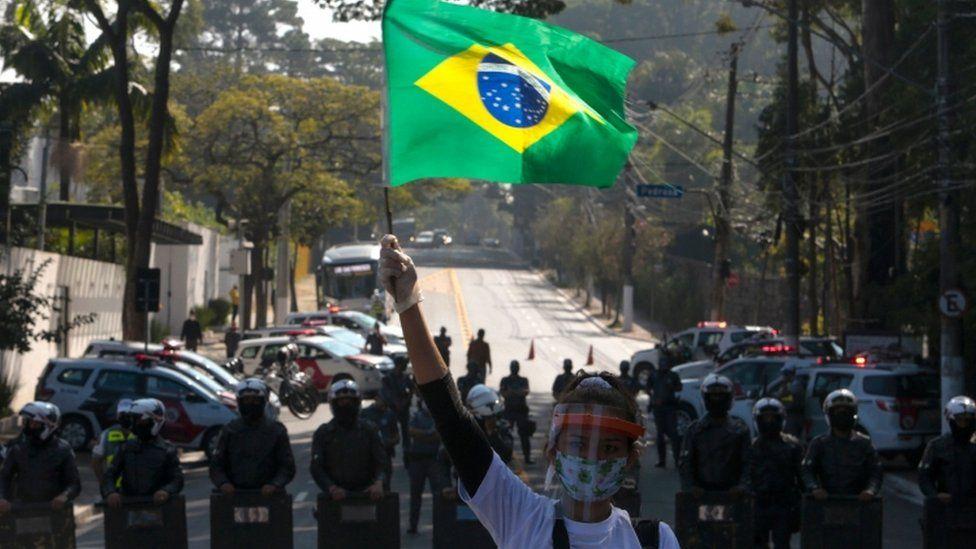 Resident of Paraisopolis favela takes part in Sao Paulo protest