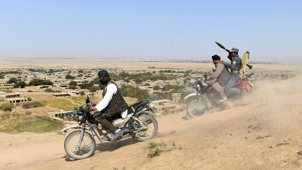 Anti-Taliban Afghan fighters on patrol in Faryab, one of the least secure Afghan provinces rife with crime and insurgent activity