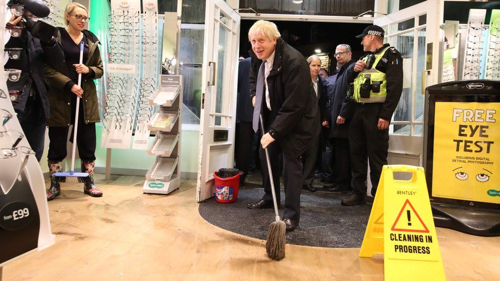 Prime Minister Boris Johnson helping with the clean up in Matlock on Friday evening