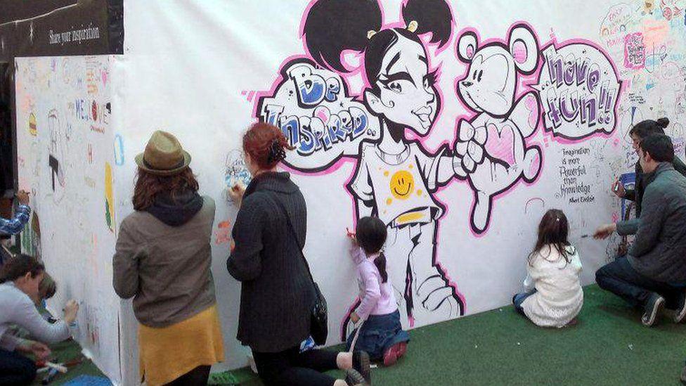 Children taking part in a graffiti workshop.