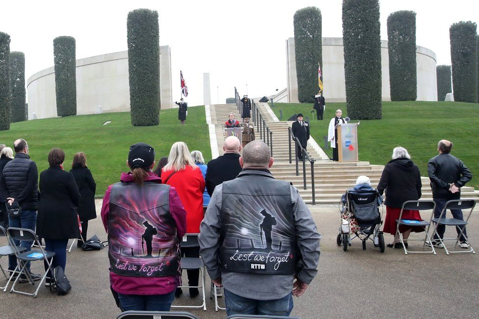 Visitors stand at the National Memorial Arboretum in Alrewas, Staffordshire