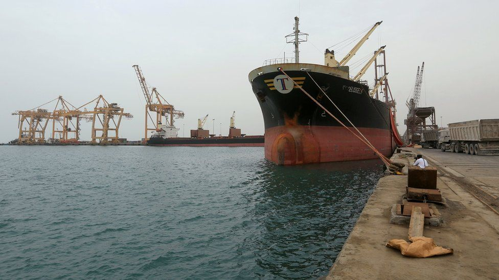 File photo showing a ship carrying grain docked at the Yemeni Red Sea port of Hudaydah (5 August 2018)