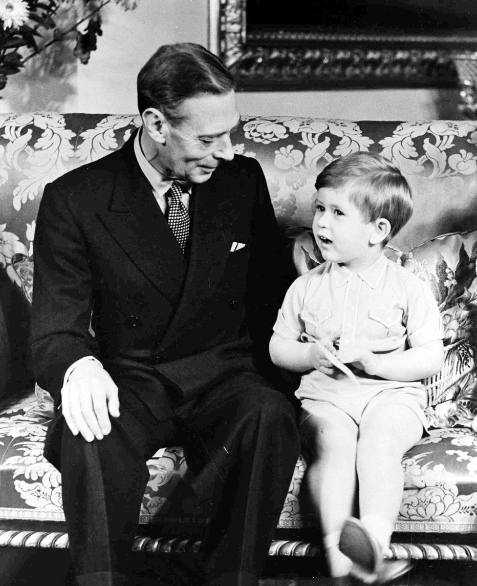 King George VI with his grandson Prince Charles