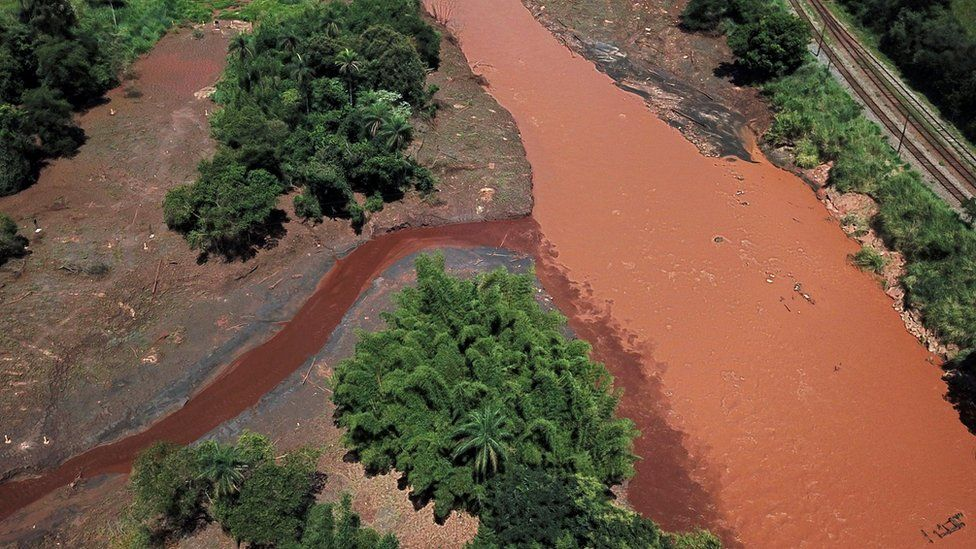 Mud reaches the Paraopeba river in Brumadinho, Minas Gerais state, Brazil on March 18, 2019, after the collapse of a dam at an iron-ore mine belonging to Brazil's giant mining company Vale on January 25, 2019