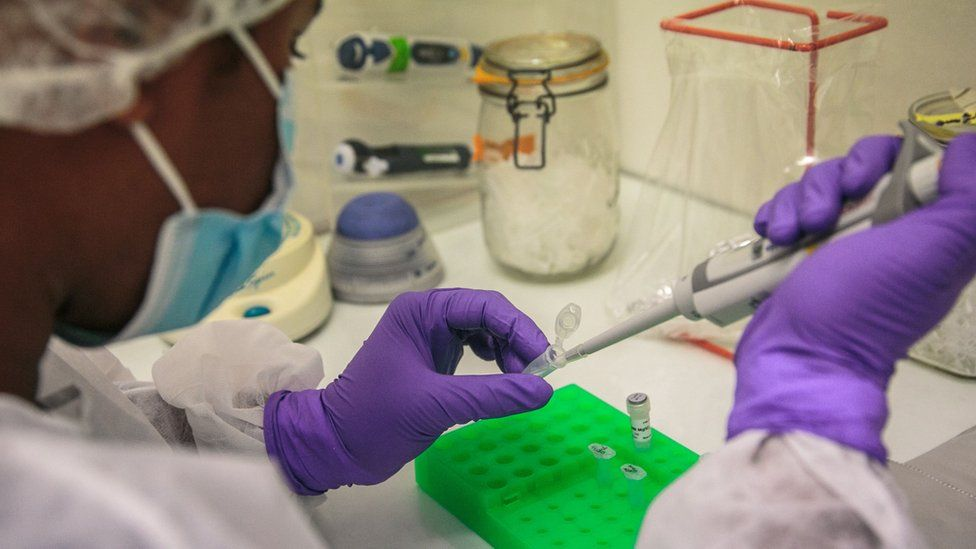 Institut Pasteur laboratory workers perform PCR (Polymerase Chain Reaction) tests to determine whether patients are positive for the new COVID-19 coronavirus, in Antananarivo, April 23, 2020