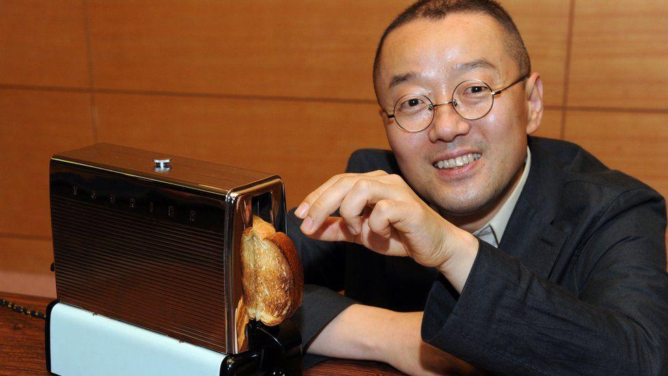 Japan's home electrical appliances collector Kenichi Masuda displaying Toshiba's 'Walking Type Toaster WT-2' in Tokyo