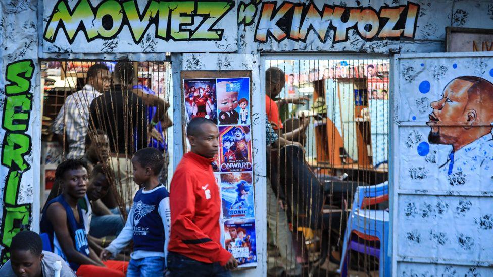 People at a barbershop in Nairobi, Kenya - Tuesday 31 March 2020