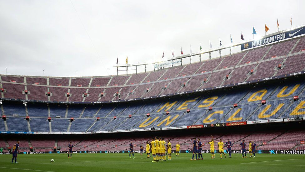 General view as Barcelona's Lionel Messi prepares to take a freekick in the empty stadium