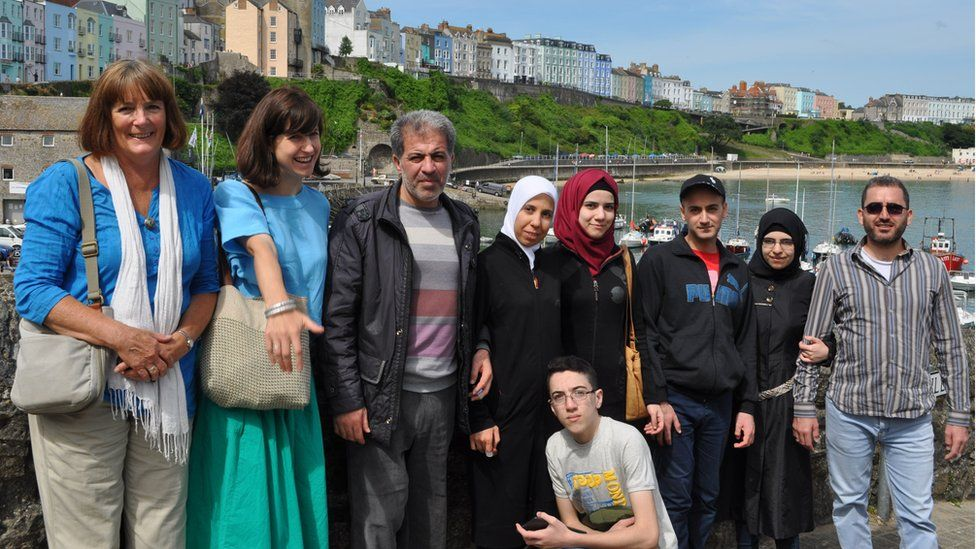 The Batak family with Jill Simpson from Croeso Arberth and interpreter Agnes Orbach on the left