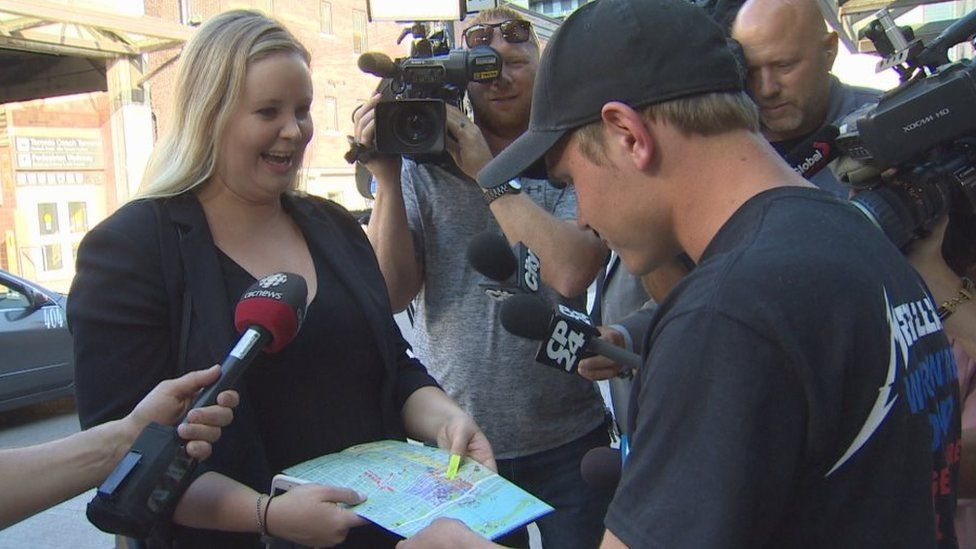 The scavenger hunt winner presented the 'doofy son' with a map of Toronto