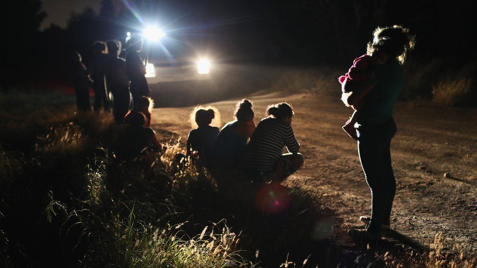 U.S. Border Patrol agents arrive to detain a group of Central American asylum seekers near the US-Mexico border