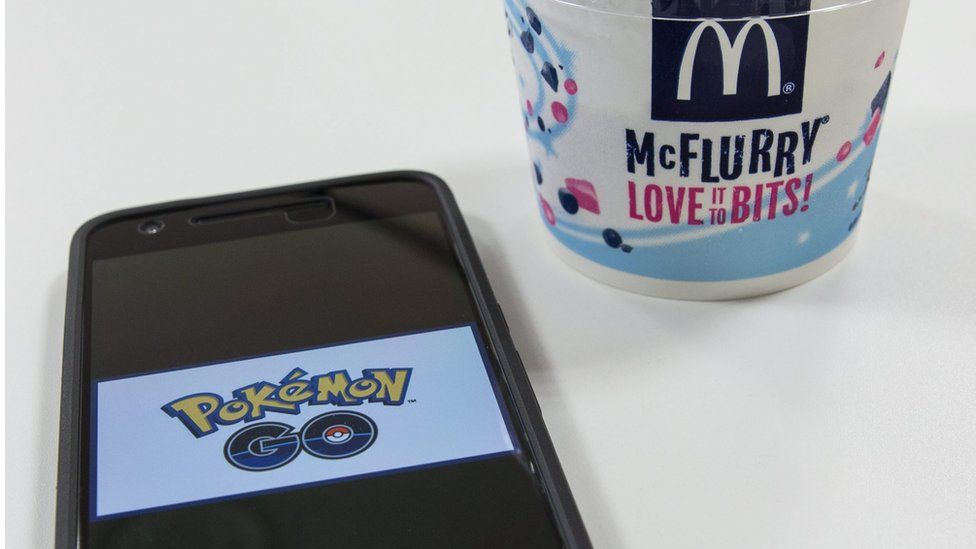 """A picture logo of Pokemon Go is seen on a smartphone inside a McDonald""""s restaurant in Tokyo, Japan, 21 July 2016."""