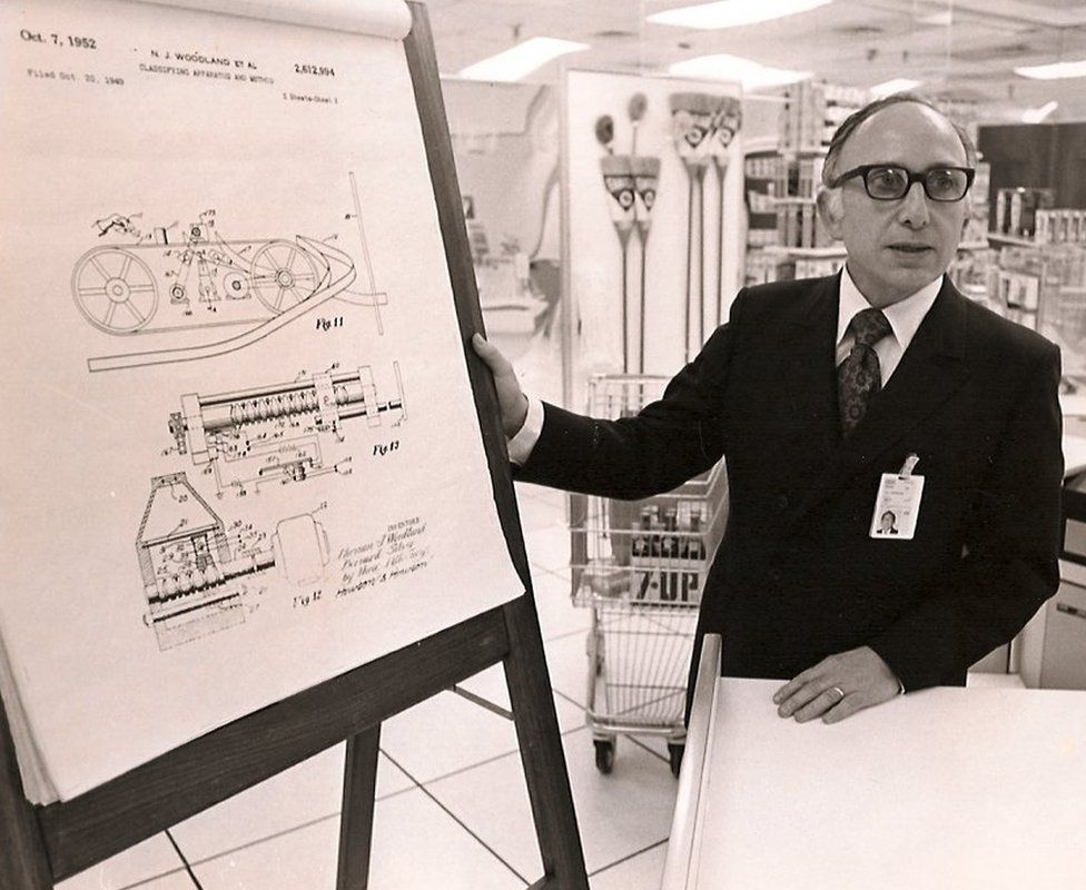 Joseph Woodland explaining his prototype scanner for products with bar codes in 1952