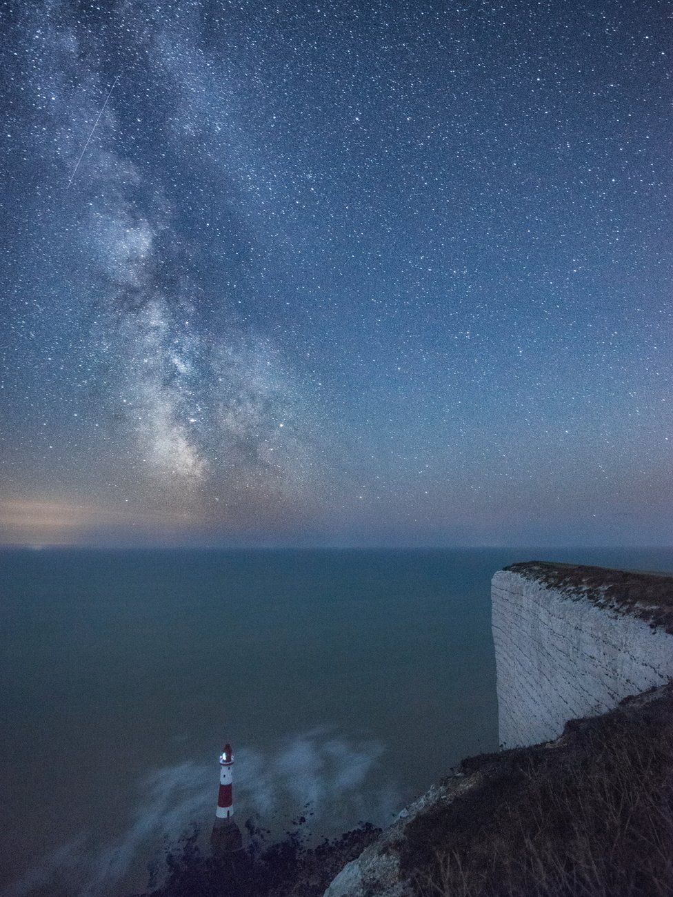 a Perseid meteor shower over sea