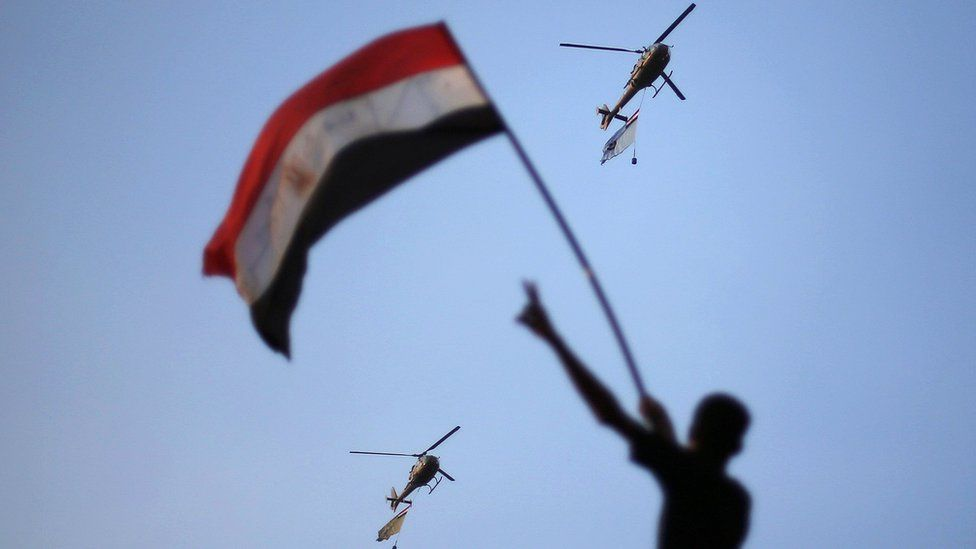 Egyptian military helicopters fly above Cairo's Tahrir Square during a protest against then-President Mohammed Morsi (1 July 2013)