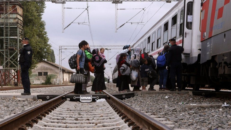 Migrants board a train leaving to Hungary at Tovarnik, Croatia