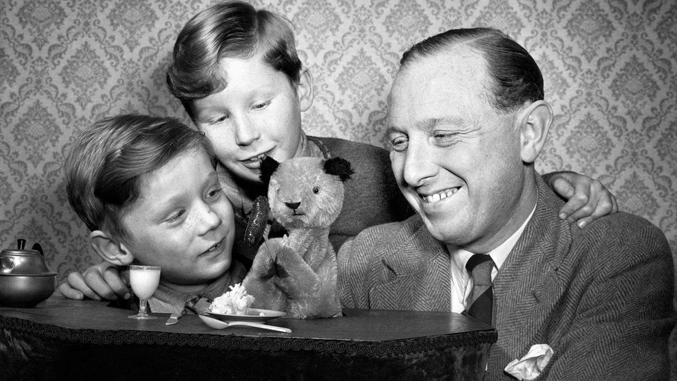 Harry Corbett with Sooty and sons David and Peter (also known as Matthew) in 1955