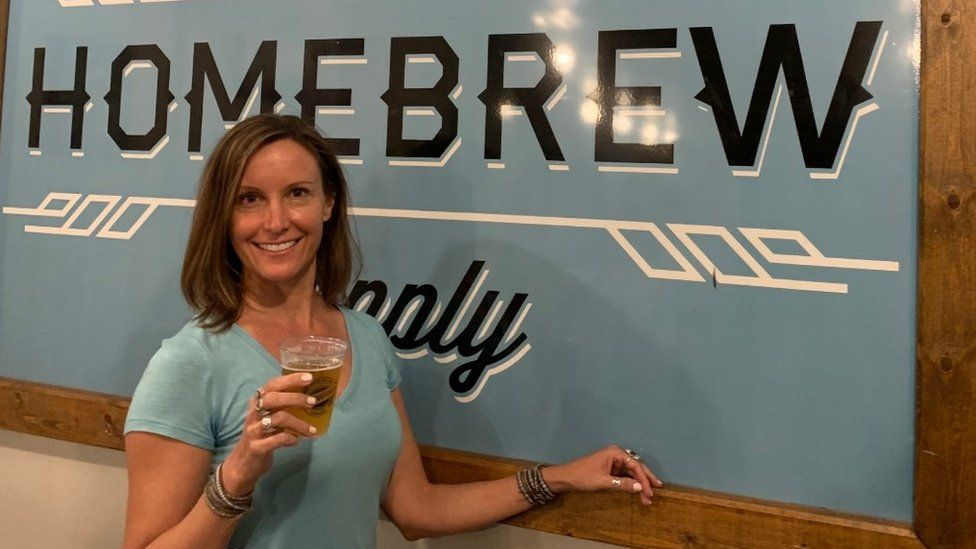 Renee Linnell holds a beer