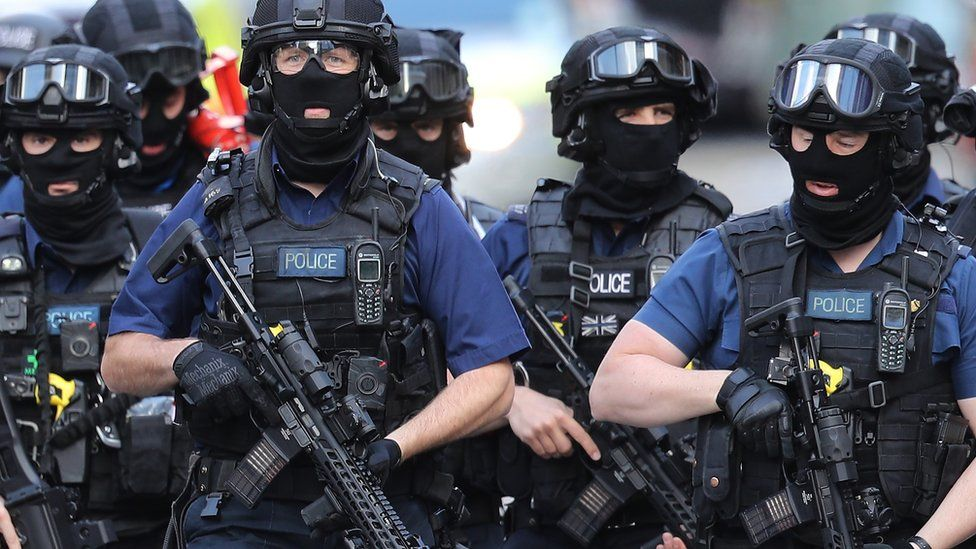 Counter-terrorism officers near the scene of the attack