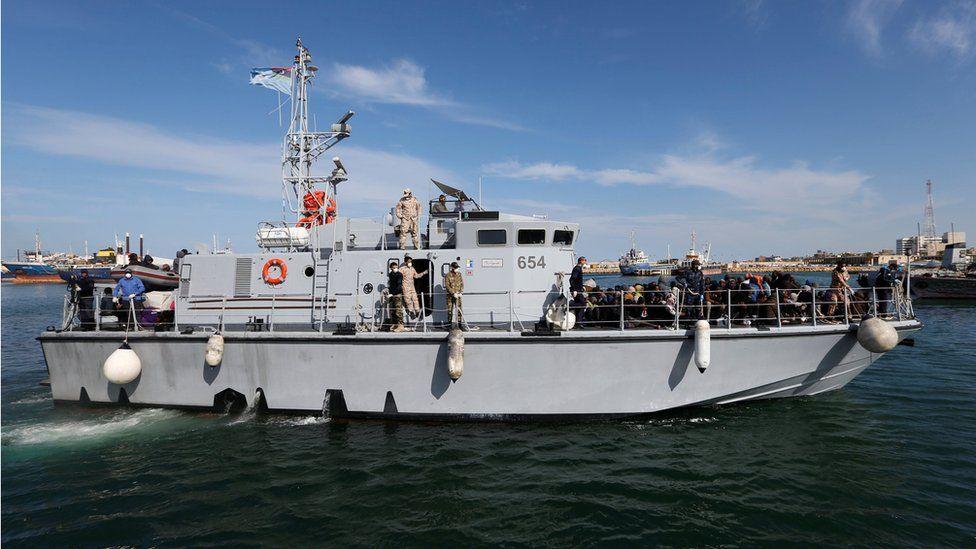 Libyan navy boat with migrants on board arrives at navy base in Tripoli, Libya 23 November 2017