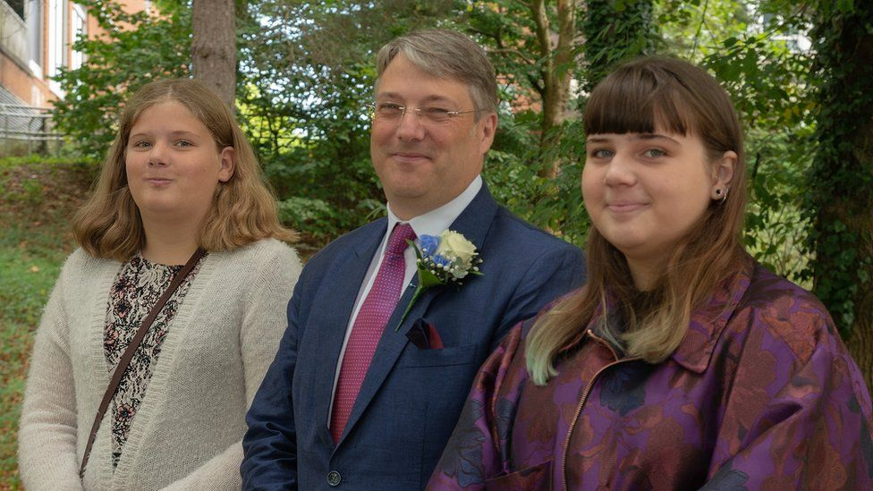Peter Freeth with his two daughters