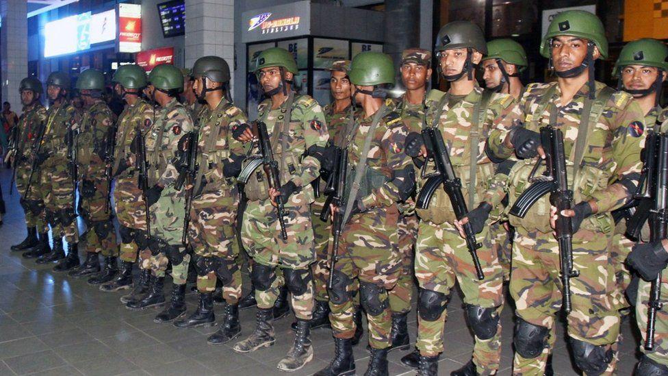 Bangladeshi security forces stand guard at the Shah Amanat International Airport in Chittagong, Bangladesh, 24 February 2019