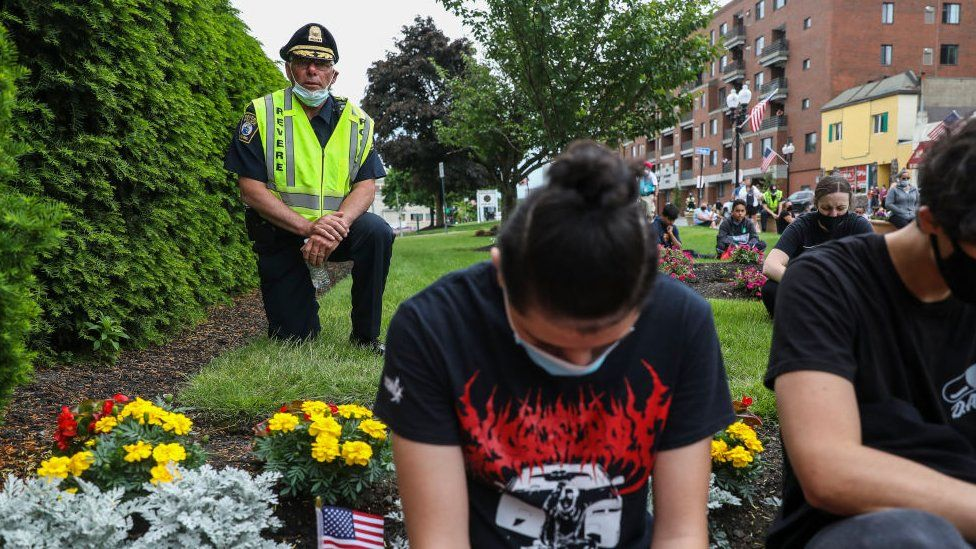 City of Revere Chief of Police joins others in taking a knee in front of Revere City Hall during a protest in support of George Floyd