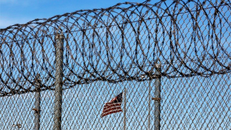 Barbed wire and an American flag at a prison in Louisiana