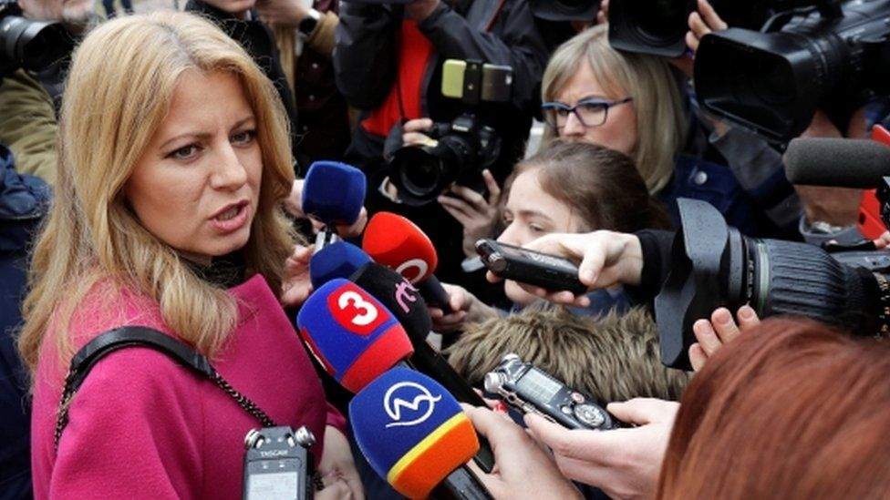 Slovakia presidential candidate Zuzana Caputova speaks to media as she arrives to cast her vote during the country's presidential elections at a polling station in Pezinok, Slovakia, March 16, 2019