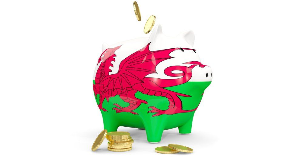 stock image of A piggy bank with the Welsh flag on it