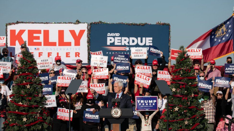 Vice-President Mike Pence speaks to the crowd during a rally in support of Sen David Purdue and Sen Kelly Loeffler