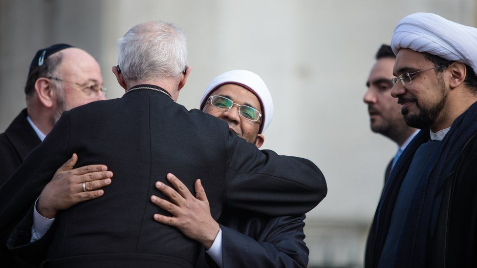 Archbishop of Canterbury, Justin Welby, embracing Sheikh Khalifa Ezzat, chief Imam and head of religious affairs at the London Central Mosque.