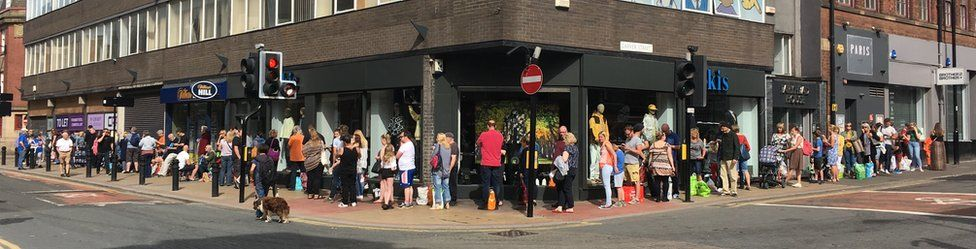 The queue for Pete McKee food bank art swap