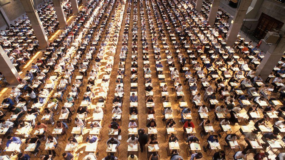 University students at exam hall, Royal Horticultural Hall, London