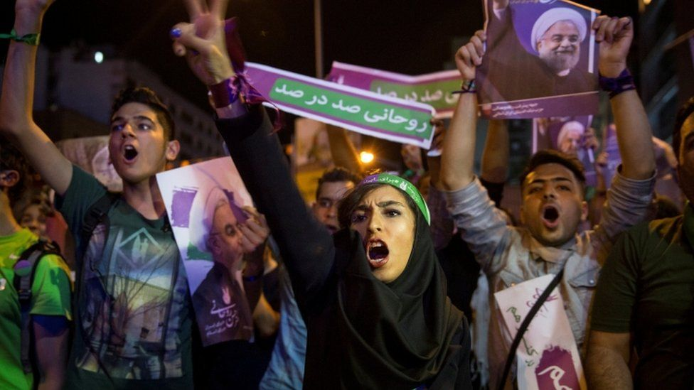 Supporters of President Hassan Rouhani take part in a campaign rally in Tehran, Iran, on May 17, 2017