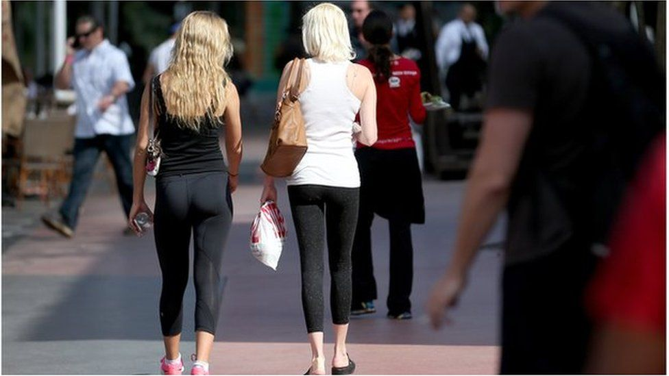 women in leggings