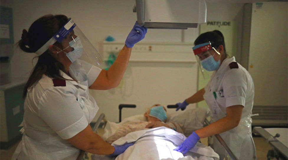 Staff care for patient