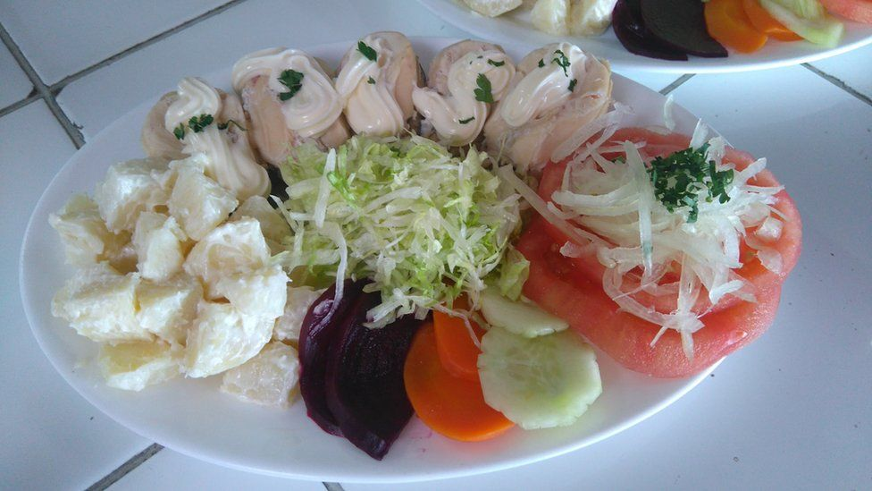 A plate of seafood with salad