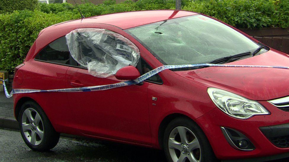 A car with a damaged window