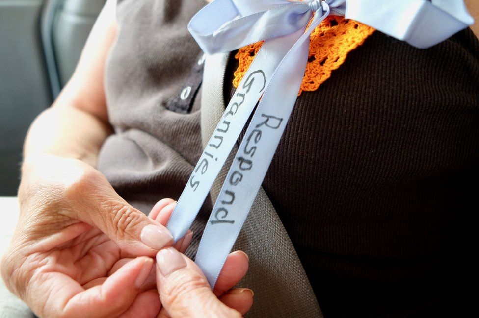 A granny strokes her ribbon