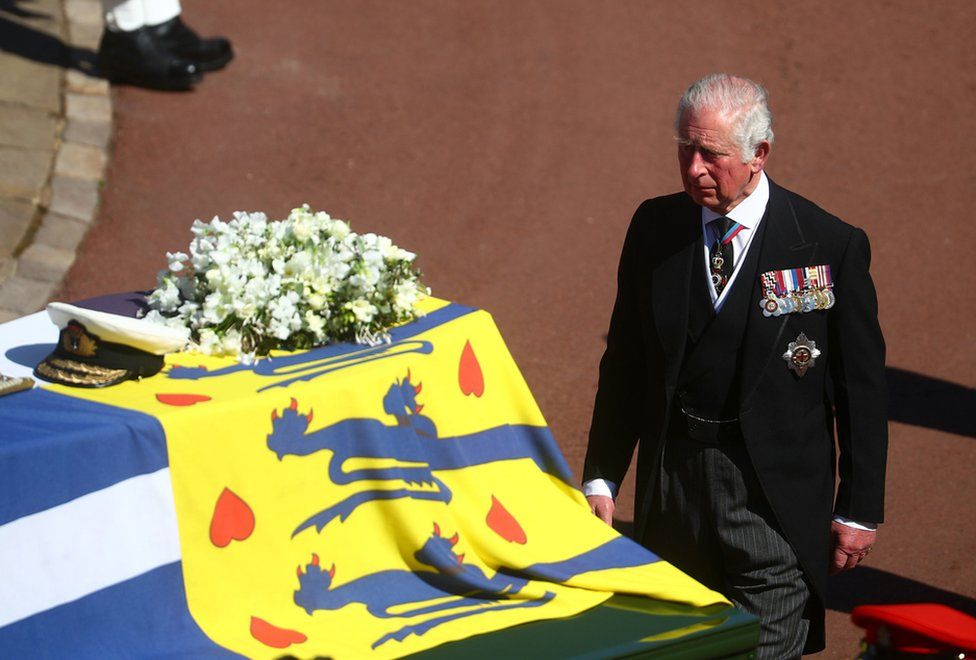 The Prince of Wales walks behind The Duke of Edinburgh's coffin, covered with His Royal Highness's Personal Standard, outside St George's Chapel, Windsor Castle, Berkshire, before the funeral of the Duke of Edinburgh. April 17, 2021.