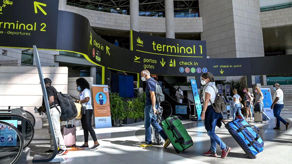 People waiting at Humberto Delgado International Airport in Lisbon