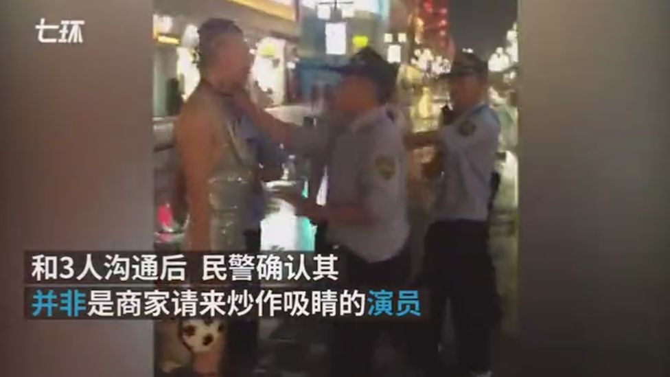 A screengrab showing a police officer pushed the man in the throat