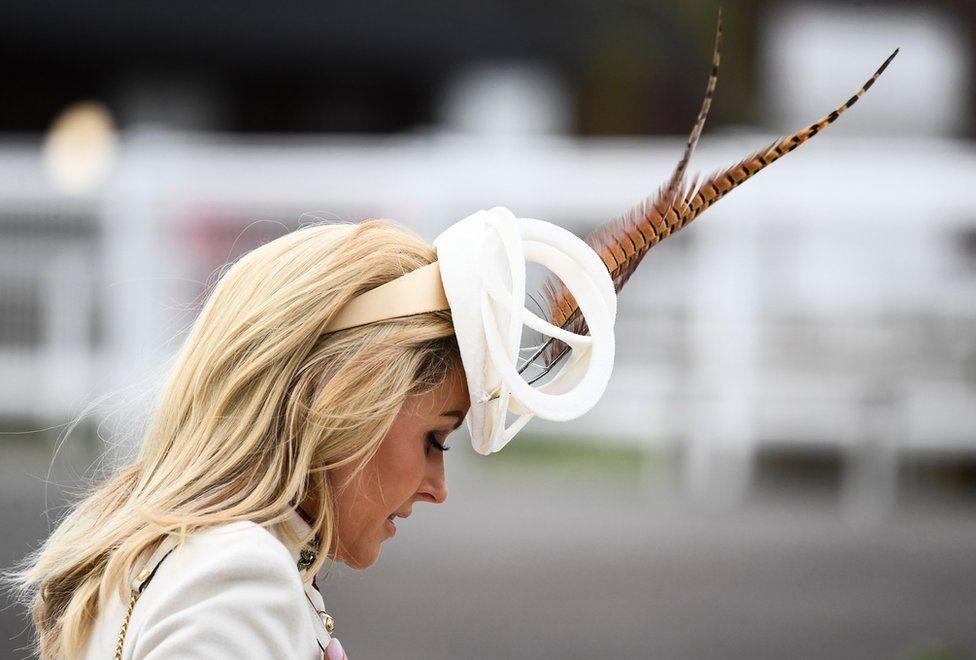 A racegoer during Ladies Day of the 2019 Cheltenham Festival at Cheltenham Racecourse