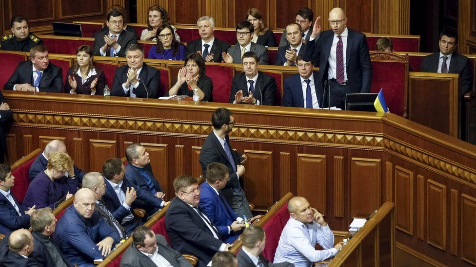 Ukraine's Prime Minister Arseniy Yatsenyuk delivers a speech during a parliament session in Kiev