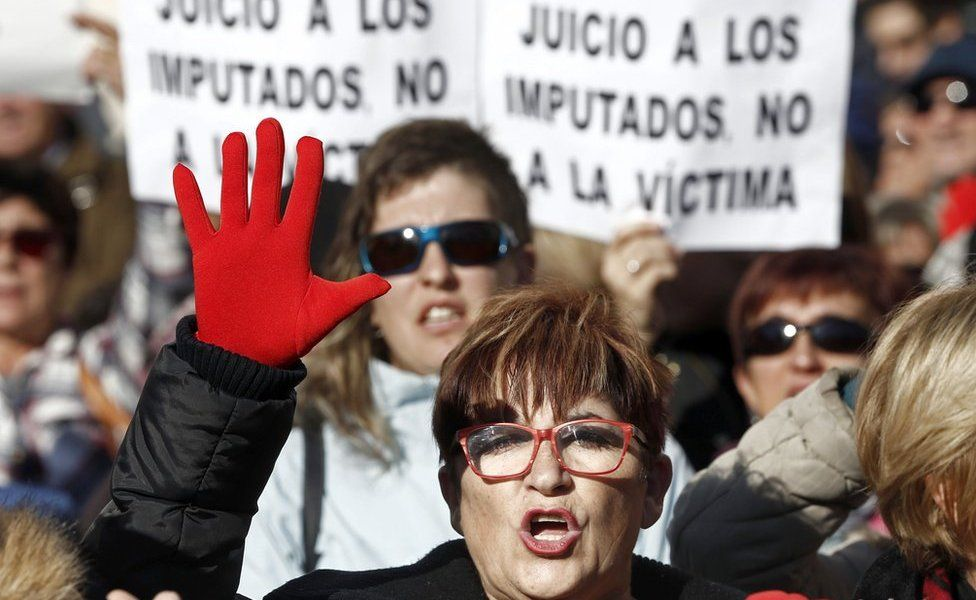 """Protesters hold banners that read """"Trial against defendants, not against the victim"""" during a protest held at the Superior Court of Navarra"""