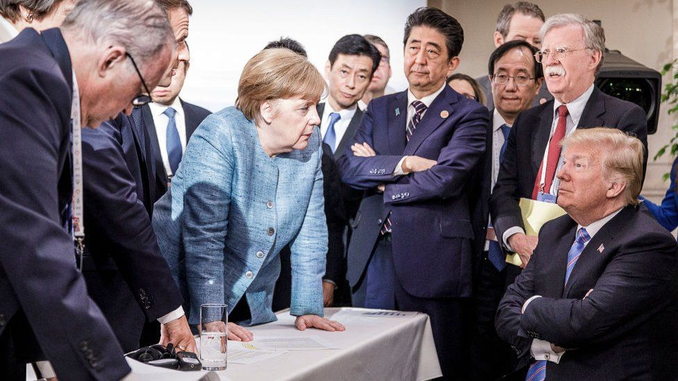 German Chancellor Angela Merkel deliberates with US president Donald Trump on the sidelines of the official agenda on the second day of the G7